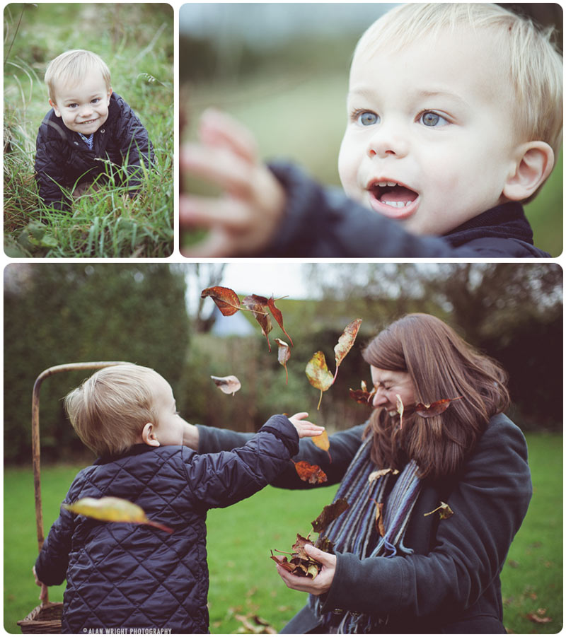 A child joyfully covers his mummy with leaves