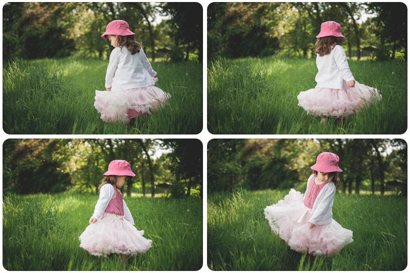 A child swirls her pink fluffy skirt