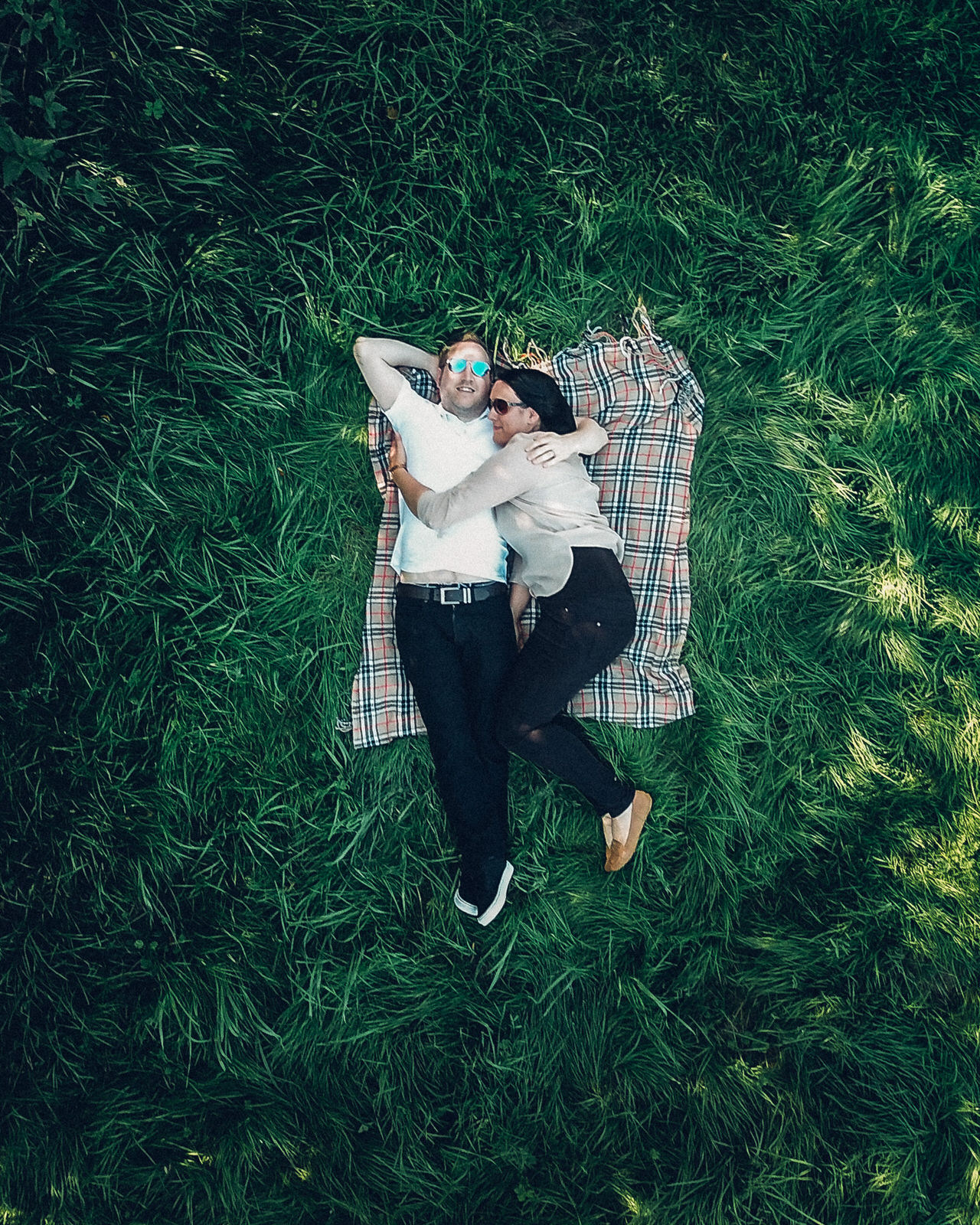 Drone portrait of couple in long grass