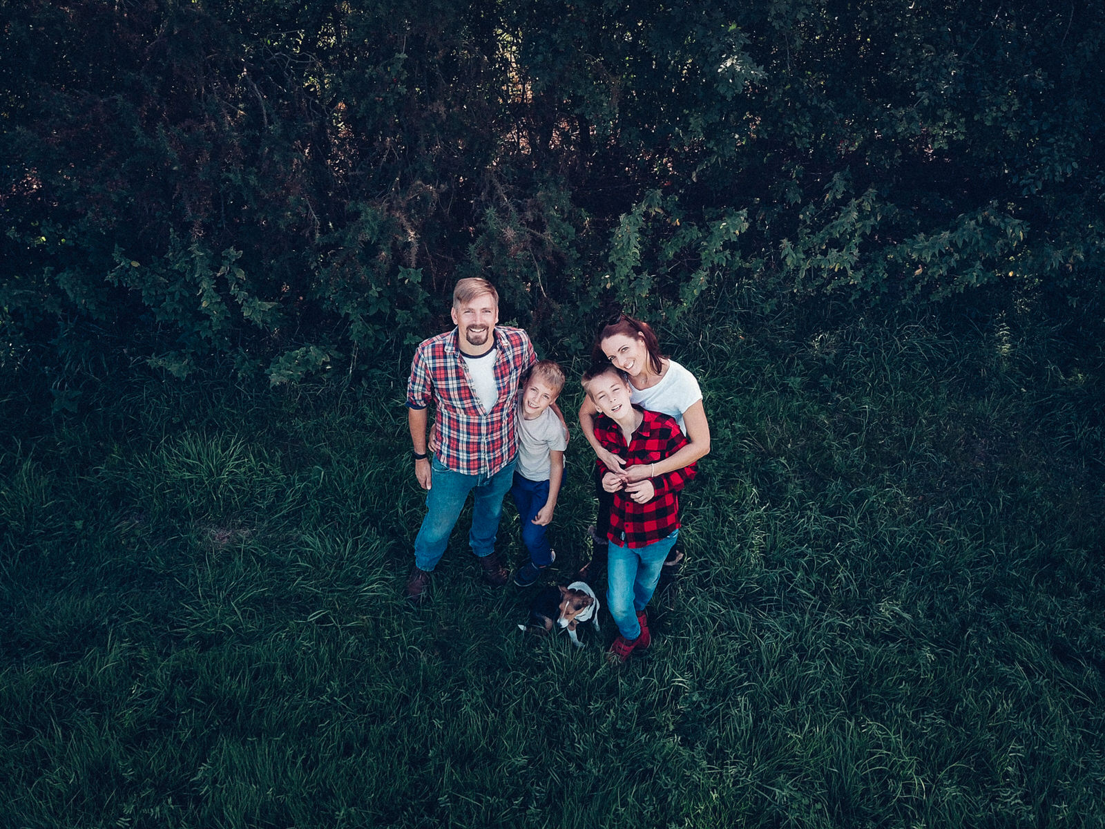 Family posing for a drone photograph