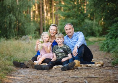 Dusk family photography on woodland path